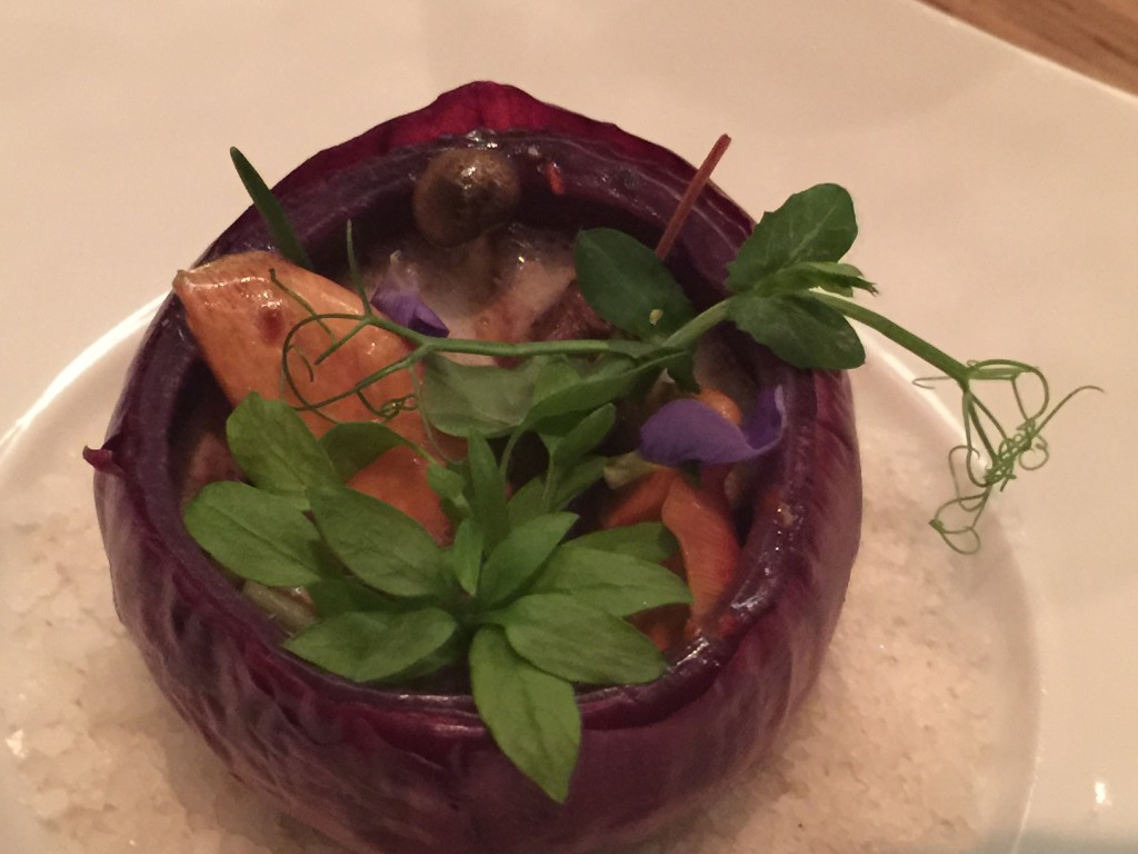 Compliments – venison stew served in red onion peel