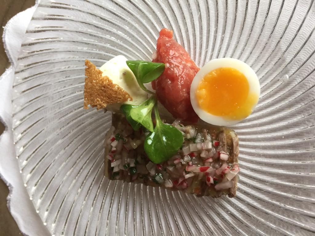 Compliments from the Chef (Beef Tartar, quail egg, slice of beef &onion)